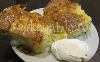 Запеканка из сырого тертого картофеля с сыром и чесноком в духовке без мяса